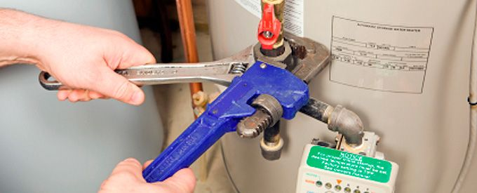 Pipe wrench fixing water heater